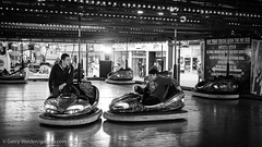 Dodgem Ride (gwpics) Tags: blackandwhite britain britishisles documentary dodgem editorialuseonly england english enjoyment europe fair fairground fun greatbritain hampshire leisure mono monochrome people pleasure southampton street streetphotography uk unitedkingdom car life socialcomment society urban