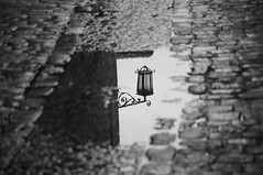 Street lamp (Jordi sureda) Tags: street blackandwhite reflection blancoynegro monochrome stone calle girona minimal reflejo catalunya simple pedra carrer reflexe senzill