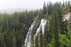 Grassi Lakes Waterfall - Canmore, Alberta (The Web Ninja) Tags: travel trees mist canada mountains green nature water rain misty canon photography photo waterfall explorer lakes rocky canadian explore rainy photograph alberta banff traveling canmore traveler grassi albertan 70d explored canon70d