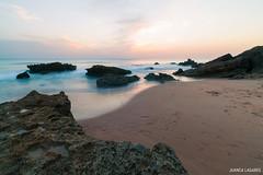 Rocas durmientes. (juancalagares) Tags: playa atardecer beach cadiz caladelpato conil filtroneutro landscape mar nd8 paisaje piedas rocas seda sunset
