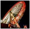 Winter Wonderland Swansea (JasRJ) Tags: winter light red wheel yellow swansea wales speed canon wonder big fairground go sigma fair round land merry merrygoround bigwheel 1020 winterwonderland 550d canon550d