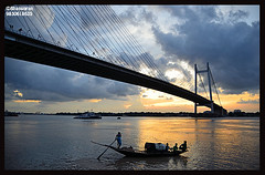 Sunset over Hooghly (bhaswaran) Tags: bridge sunset west river evening boat monsoon second kolkata bengal calcutta boatman vidyasagar setu hooghly sethu