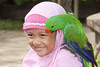 Islamic Girl Enjoying a Parrot (marlin harms) Tags: pettherapy muslimgirl islamicdress tamanburungbalibirdpark islamicgirl indonesianislamicgirl