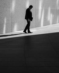 Heat (Rupert Vandervell) Tags: street city sun white man black london texture sunshine stone bag shoes shadows bright geometry vibrant cigarette shapes atmosphere olympus smoking suit sidewalk human rupert brickwork em5 vandervell