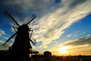 De Herder in the evening sun (Harry Kool) Tags: mill weather clouds canon eos wind wolken zon medemblik molen subset zonsondrgang meelmolen
