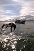 Verão (Ricardo Cosmo) Tags: sea brazil man praia beach brasil swimming boat mar jumping barco verão summertime portobelo santacatarina olympuspen homem nadando pulando duetos ricardocosmo mzuikodigital
