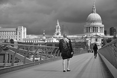 STORM BREWING (DESPITE STRAIGHT LINES) Tags: woman backpack walk walking milleniumbridge bridge legs shoes commutersonmilleniumbridge commute commuters stpaulscathedral stpauls cathedral architecture work metal street london city capital overcast stormy stormbrewing stormyweather cloudy shadows nikon d7000 nikond7000 nikongp1 nikon18105mm paulwilliams despitestraightlines getty flickr roadtohell theroadtohell womancommuteronmilleniumbridge themorningwalktowork workdayblues ilobsterit
