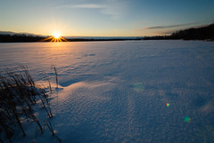 Wasteland (John Bradtke) Tags: winter light sunset sky sun lake snow ice lens star shadows michigan wideangle flare rays icy barren wasteland nikond200