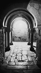 Walking towards the light... (chris.fielder83) Tags: shadows light worship ancient old vision perspective tamron d3300 nikon france serrabonapriory archway bw blackandwhite arch stone
