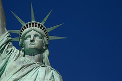 Statue of Liberty against Deep Blue Sky (baddoguy) Tags: nopeople newyorkcity backgrounds statueofliberty americanculture anthropomorphicface art blue clearsky closeup colorimage copyspace craft crown day easternusa famousplace femalelikeness freedom friendship horizontal humanrepresentation independence individuality internationallandmark libertyisland lowangleview manhattannewyorkcity nationallandmark outdoors partof photography sculpture sky statue traveldestinations usa