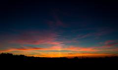 Sky on Fire. (scottmirams_photography) Tags: sunset orange blue lowsun silhouette landscape 600d canon sky colour clouds