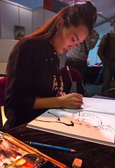 Autographing her comic for me. (Azariel01) Tags: 2016 bruxelles brussels belgique belgie belgium parc art ftedelabd stripfeest bd comic bandedessinne ddicace dessin drawing peinture paint zaodao chinoise chinese artist artiste autograph lesouffleduventdanslespins