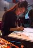 Autographing her comic for me. (Azariel01) Tags: 2016 bruxelles brussels belgique belgie belgium parc art fêtedelabd stripfeest bd comic bandedessinnée dédicace dessin drawing peinture paint zaodao chinoise chinese artist artiste autograph lesouffleduventdanslespins