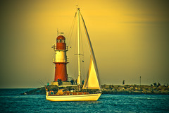 coming home (bocero1977) Tags: autumn warnemnde nature water germany mood outdoor balticsea sailboat light blue trip colors sailing red lines moody clouds fineart boat atmosphere lighthouse sea sky