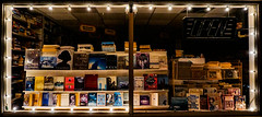 bookstore (brad_cotten) Tags: bright night lights window store books colourful vibrant