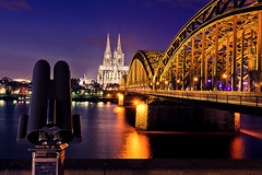 Cologne Night Lights (_flowtation) Tags: longexposure bridge winter light sky reflection church water night reflections river lights nikon cathedral nacht bokeh dom kirche clear binoculars bluehour florian fluss rhine rhein lichter rhineri
