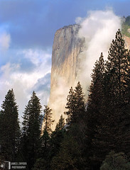 Daybreak, El Capitan (James L. Snyder) Tags: california above park morning autumn trees cliff usa sunlight mountain painterly fall rock vertical fog wall clouds forest spectacular early moving nationalpark woods october veiled natural awesome great rocky grand sierra formation glorious evergreen pines valley yosemite granite translucent tall yosemitenationalpark passing fading soaring elcapitan sierranevada fleeting enduring majestic vanishing monolith chiaroscuro 2009 ephemeral sylvan looming breathtaking magnificent shrouded gleaming daybreak clearing towering yosemitevalley evanescent lofty monumental clinging shaded spectacle grandeur disappearing ageless mariposacounty frontlighting