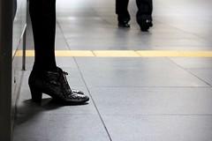 At a station (tanakawho) Tags: woman man black station shoes dof leg railway tights line fragment tanakawho weekendshowcase