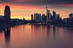 Golden City (_flowtation) Tags: longexposure sunset red orange skyline night reflections nikon cityscape sonnenuntergang purple cloudy frankfurt main le deutschebank banks frankfurtammain mainriver ffm maintower 2470mm helaba europeancentralbank europischezentralbank deutschherrnbrcke lzb nikon2470mm d7000 nikond7000 commerzabank mainplaca