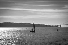 Sailing away (John Getchel Photography) Tags: sanfrancisco california blackandwhite water sailboat sailing goldengate boating