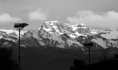 swiss mountain view (duqueıros) Tags: schnee bw panorama snow mountains lamp clouds schweiz switzerland lampe blackwhite view suisse wolken berge sw headlight aussicht svizzera schwarzweiss swissalps scheinwerfer kantonzürich duqueiros