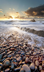 Sound of Pebbles (Twogiantscoops) Tags: longexposure sunset seascape canon cornwall pebbles sandymouth sandymouthbay iplymouth twogiantscoops movementofthesea
