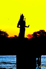 Lord Shiva !!! (Rambonp love's all creatures of Universe.) Tags: morning red wallpaper sky india mountains nature water birds silhouette yellow clouds sunrise river landscape temple paradise shiva shiv ganges reflectiontrees haridwar gangariver shanker bholenath harkipauri uttaranchalpradesh atthecrackofdawn