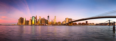 Manhattan Morning (Rex Maximilian) Tags: city nyc newyorkcity morning panorama skyscraper sunrise twilight manhattan highrise eastriver metropolis statueofliberty suspensionbridge bigapple lowermanhattan eastcoast brooklynbridgepark travelphotography ferrydock 617photograph 6x17aspectratio