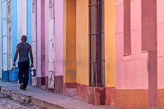 Colorful Trinidad (Mitch Ridder Photography) Tags: cuba cuban island islandofcuba caribbean caribbeanisland largestcaribbeanisland trinidad mountaintown color colorfulltrinidad trinidadstreet mancarryingbuckets sunrise
