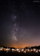 Mackerel Cove Fireworks (rodeonexis - photography) Tags: mackerelcove harpswell maine ocean inlet boats reflection milkyway stars evening midnight night landscape astrophotography casco bay canon wide angle glow fireworks 4thofjuly