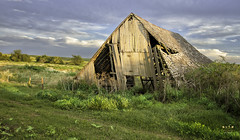 Fading From the Landscape (SteveFrazierPhotography.com) Tags: country countryside barn wooden delapidated old decaying fallingapart farmland evening stevefrazierphotography hdr midwest america rural boards