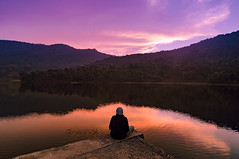 Disconnect (swearingpirate) Tags: sunset sky lake sunlight perspective evening india mountains reflections travel landscape clouds nikon