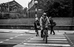 2016_237 (Chilanga Cement) Tags: fuji fujix100t x100t xseries x100s x100 zebra zebracrossing bicycle man preston prestonstreetphotography stripes bicycles bw blackandwhite lady woman