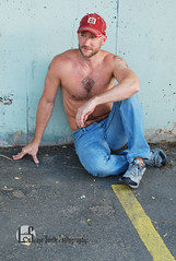 Keith (Levi Smith Photography) Tags: hat man shirtless jeans parking lot blue wall red beard smile hot muscle chest hair buff dude mens men fashion