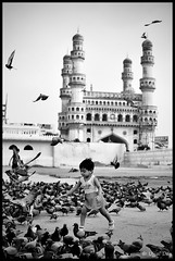 The Pigeon Runner (ujjal dey) Tags: blackandwhite monochrome kids pigeon dreams charminar ujjal nikond90 nikon18105mm ujjaldey ujjaldeyin ujjaldeyphotography thepigeonrunner