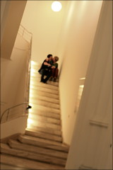 stairway to heaven (piktorio) Tags: friends sun blur berlin love museum stairs germany kiss couple heaven sitting availablelight candid indoor snap stairway moment sneaky unknowncouple unrecognizable calinago waistsnap