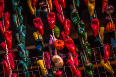 Hanging Peppers (Mabry Campbell) Tags: street november red usa newmexico santafe green photography design us photo colorful paint unitedstates object unitedstatesofamerica 85mm objects tags photograph hanging peppers 100 nm common 2012 f20 commonthings ef85mmf18usm santafecounty ¹⁄₂₅₀sec mabrycampbell november242012 201211243