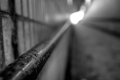 Old Street underpass (Gary Kinsman) Tags: light bw london water underpass blackwhite droplets ramp shoreditch canon350d handrail railing f18 2008 canonrebelxt oldstreet ec1 lightattheendofthetunnel sigma20mmf18