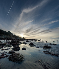 Skyfall at Totland Bay (s0ulsurfing) Tags: uk blue light sunset england sky cloud sun sunlight reflection art english nature water lines weather silhouette clouds composition canon reflections landscape island bay coast march scenery skies contrail quiet peace natural dusk pov stones patterns wide blues tranquility wideangle calm reflected coastal isleofwight solent coastline lowtide picturesque landschaft isle tranquil nube wight mellow foreground meteorology cirrus 2010 contemplation nephology vapourtrails condensationtrail 10mm totland sigma1020 totlandbay s0ulsurfing fineartlandscape vertorama