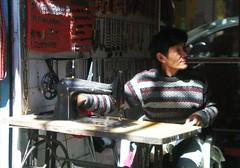 Tibetan Tailor in Dharamsala (Keritheartist1) Tags: india man men children chains women sewing delhi indian machine tools keri jumper tibetan cloth punjab necklaces neddle seamster keritheartist