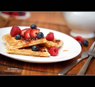 Waffles and berries with maple syrup for breakfast