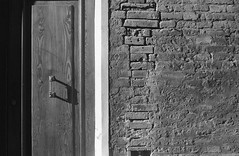 (giovanegian) Tags: door wood morning autumn light shadow italy brick wall tranquility calm silence modena absence selfdev agfasupersilette solinar3545 fujineopanss80iso expiredapril2010 stöcklertwobatha6b520°c