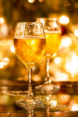 Two champagne glasses ready to bring in the New Year (AgFineArtPhotography.com) Tags: christmas new eve winter light party holiday tree love glass night festive happy gold golden design bottle wine crystal drink box anniversary background toast champagne year beverage newyear sparkle celebration card gift alcohol bow cheers romantic ribbon merry congratulations celebrate occasion liquid bubbly happynewyear christmaslight christmasgreeting cardchristmas christmasmerry christmaspattern backgroundchristmas