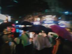 It's been an umbrella kind of night in downtown Ho Chi Minh City. (genochio) Tags: saigon vietnam hcmc