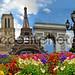 Travel background. Symbols of Paris: Eiffel Tower, Cathedral of Notre Dame de Paris, Sacre Coeur Basilica, Arc de Triomphe, Street lamps of Alexandre III bridge
