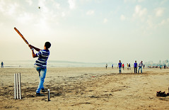 """It's a SIX!"" ([s e l v i n]) Tags: india game play shot action cricket bowling bombay batting mumbai six versova beachcricket versovabeach indiancricket ©selvin cricketshot boysplayingcricket"
