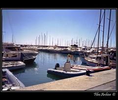 Italy. (Picture post.) Tags: sunlight film water reflections boats eau jetty liguria bluesky summertime mediterraneansea italianriviera moorings celleligure filmarchive
