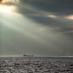 distant boat (JonBartonPhoto) Tags: autumn cloud sun ontario canada fall landscape boat factory ship greatlakes kingston lakeontario