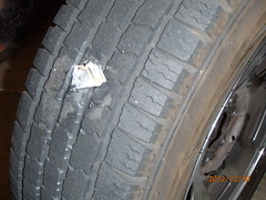 Flat Tire (cjacobs53) Tags: black wheel flat tire rubber spike jacobs reflector jacobsusa 112picturesin2012 2012picture