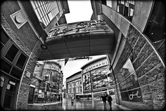 The Gate and Debenhams, Newcastle upon Tyne. (CWhatPhotos) Tags: thegate gate shopping centre shops mono monochrome blackandwhite blackwhite debenhams street newcastle city north east england uk canon eos dslr 7d opteka 65mm aspherical manual focus fisheye fish eye lens people buildings pictures picture photo photos photograph photographs foto images image that have which with contain nearchinatown near close chinatown primelens prime cwhatphotos flickr